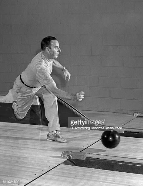 1950s MAN THROWING BOWLING...
