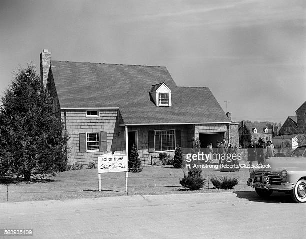 1950s MODEL HOME WITH SIGN OF LEVITT SONS EXHIBIT HOME PEOPLE MILLING ABOUT