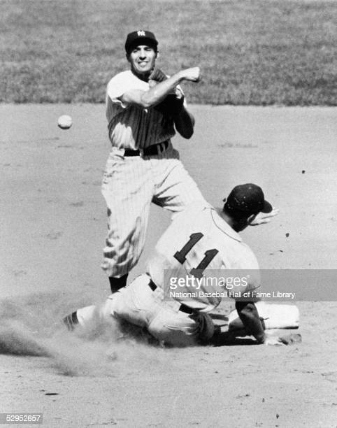 Phil Rizzuto of the New York Yankees throws from second base in a circa 1950s game at Yankee Stadium in Bronx, New York. Rizzuto played for the...