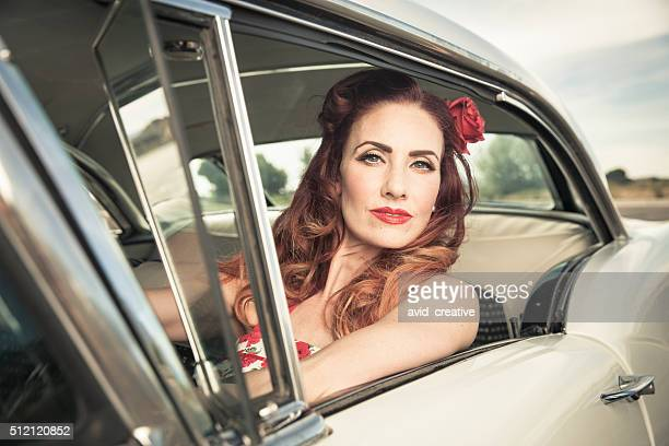 1950s Redhead Glamour Woman Driving Classic Car