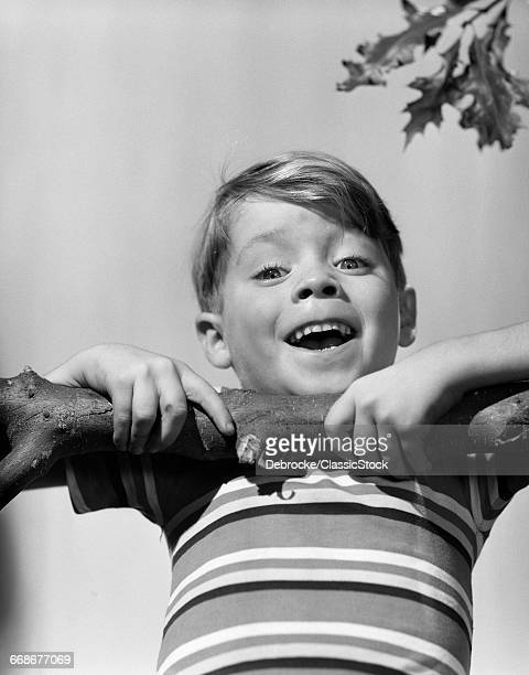 1950s SMILING BOY DOING...
