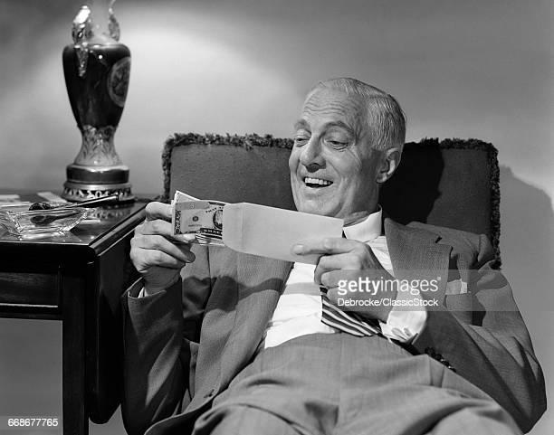 1950s SMILING SENIOR MAN...