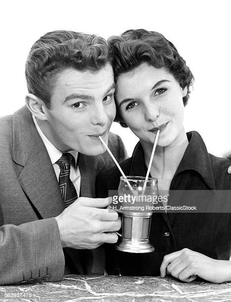 1950s SMILING YOUNG COUPLE...