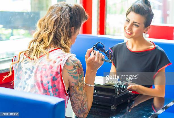 1950s style - two women talking - pjphoto69 stock pictures, royalty-free photos & images