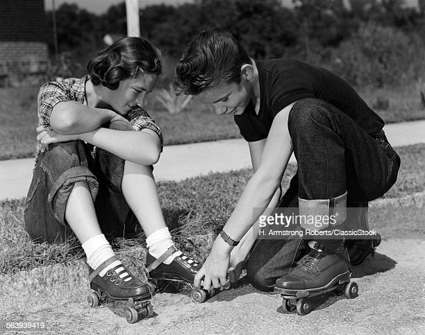 1950s TEEN BOY HELPING...