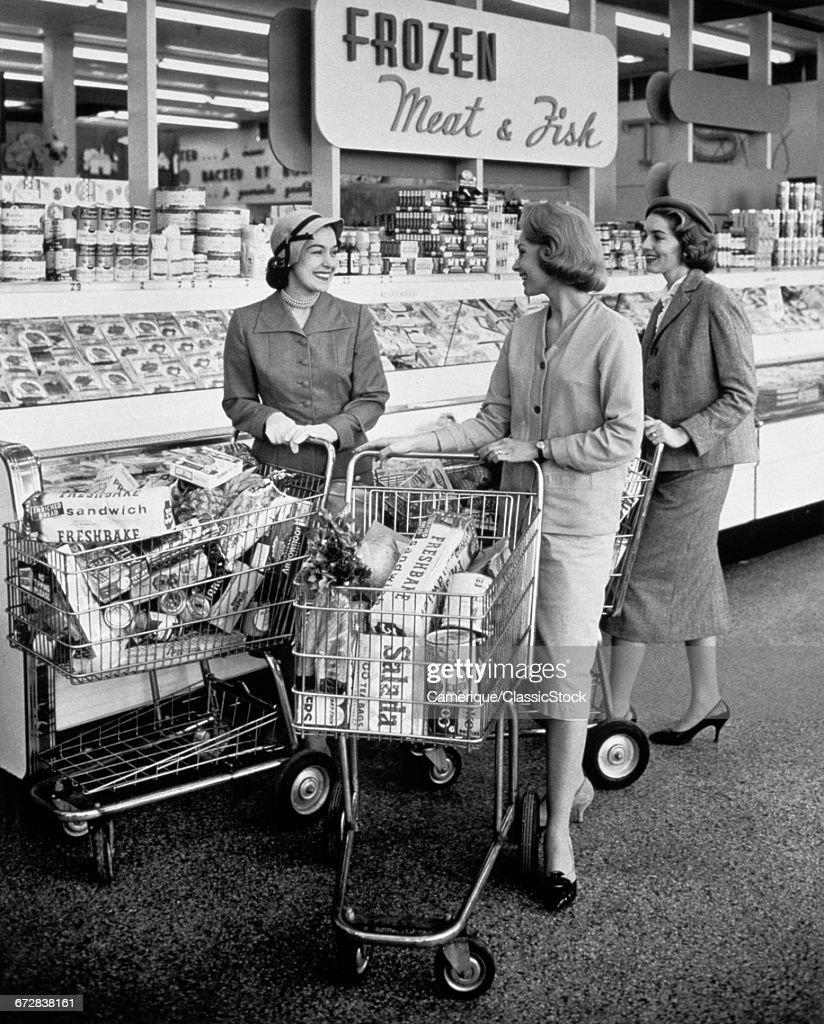 1950s THREE WOMEN PUSHING... : Stock Photo