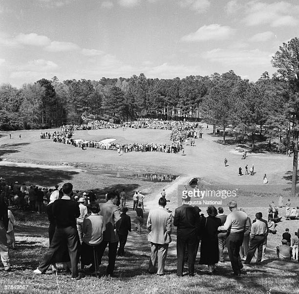 Tournament play on the 6th hole during a 1950s Masters Tournament at Augusta National Golf Club in Augusta Georgia