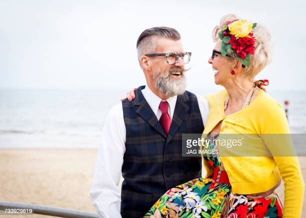 1950s vintage style couple laughing at beach