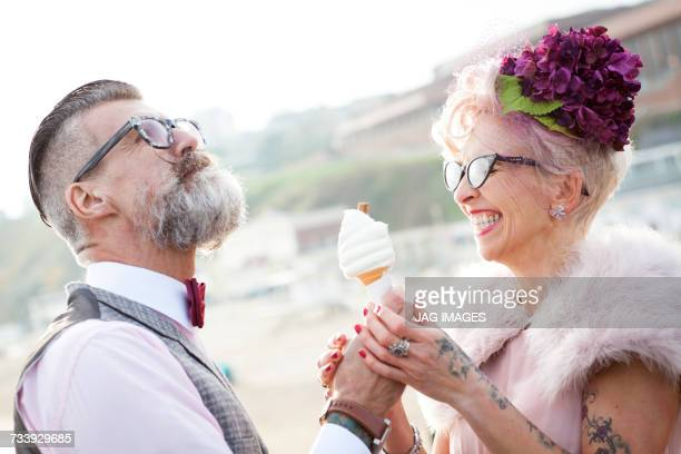 1950s vintage style couple with ice cream cone at beach