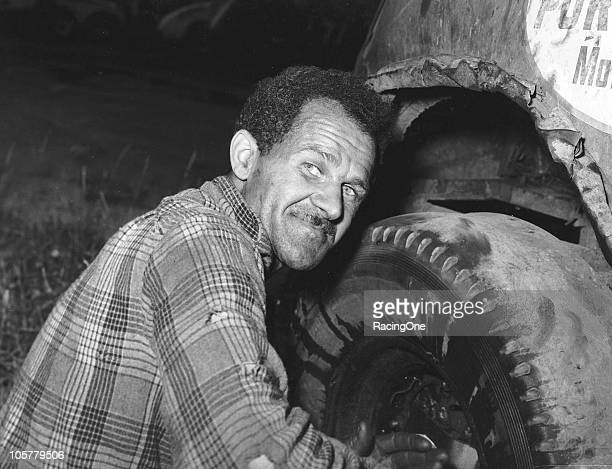 Wendell Scott works on one of his Modified stock cars in the 1950s. Scott would go on to run 495 NASCAR Cup races and is the only African-American...