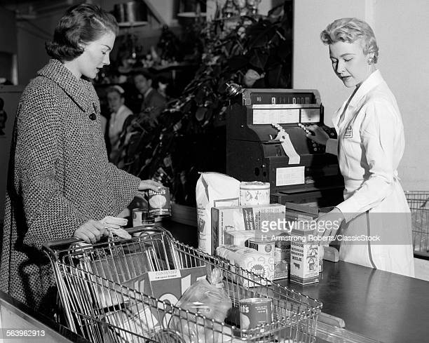 1950s WOMAN AT GROCERY...