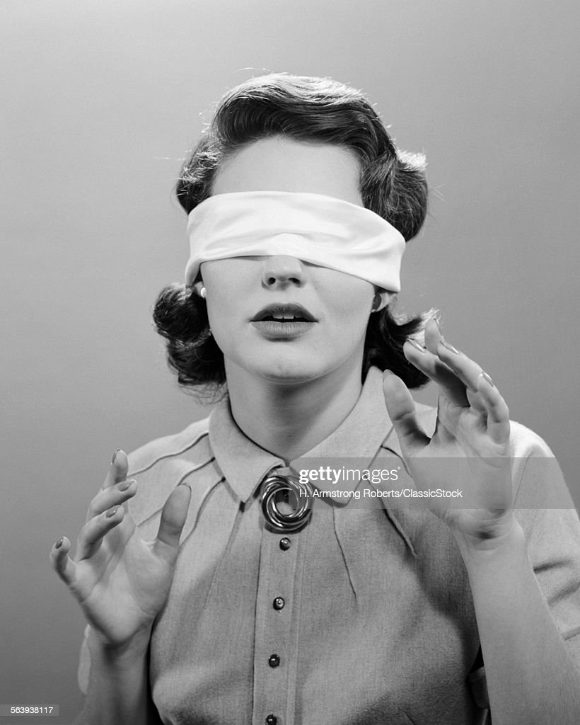 1950s WOMAN BLINDFOLDED : News Photo