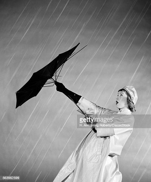 1950s WOMAN IN RAIN COAT...