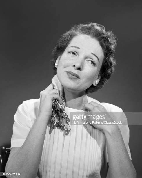 1950s WOMAN TOO WARM SWEATING PULLING AT COLLAR OF BLOUSE AND MOPPING NECK WITH HANDKERCHIEF HOT UNDER THE COLLAR