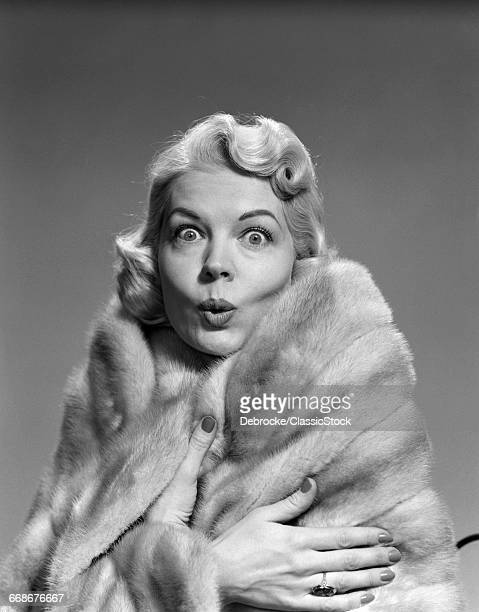 1950s WOMAN WRAPPED IN FUR...