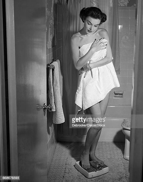 1950s WOMAN WRAPPED IN...