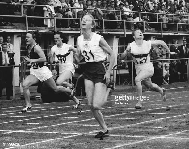 1952Helsinki Australia Photo shows the finish of the woman's 80 meters hurdles final showing Shirley Strickland of Australia winning with Maria...