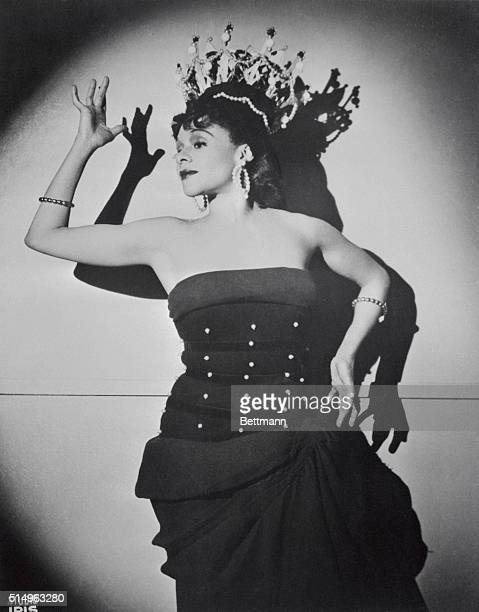 Dancer Katherine Dunham 3/4 body shot with raised arms during performance