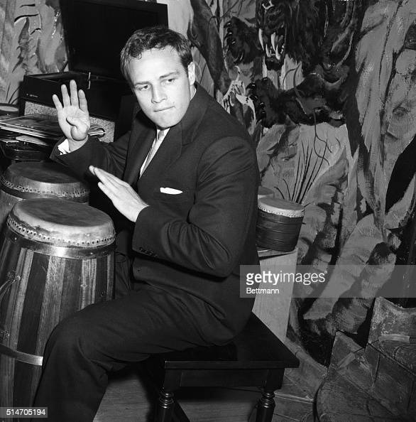 1955hollywood-ca-marlon-brando-plays-the-bongos-in-his-hollywood-a-picture-id514705194