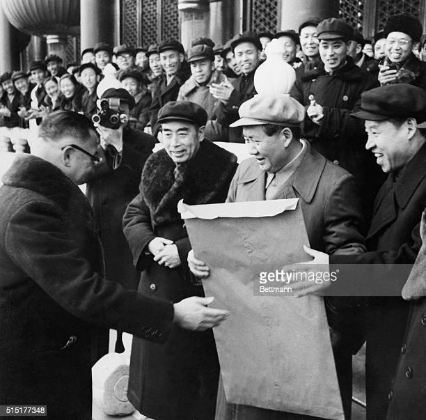 Peiping, China: Lo Sung-Sheng , representative of the capitalists here, presents a letter to Mao Tse-Tung during a mass rally celebrating the success...