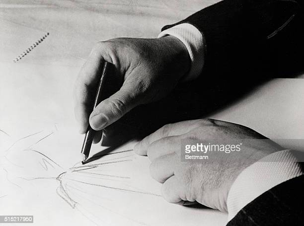 1957Hands of famous designer Christian Dior as he makes a sketch shortly before his death on October 24th 1957