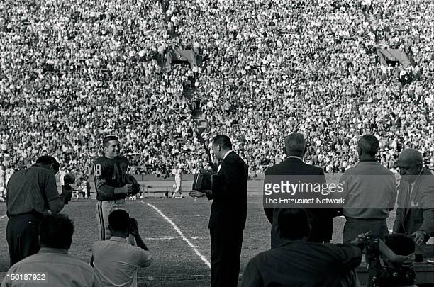 Green Bay Packers at Los Angeles Rams Football - Los Angeles Memorial Coliseum. Rams Hall of Fame linebacker/guard Les Richter stands on the sideline...