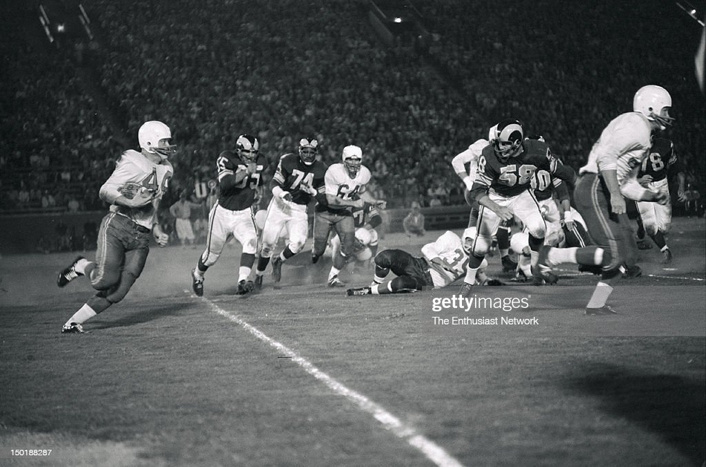 Chicago Cardinals at Los Angeles Rams Football - Los Angeles Memorial Coliseum Preseason Game. Cardinals halfback John David Crow(44) runs the ball as Rams defenders come in to try and make the tackle.