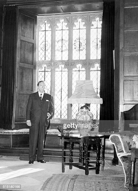 1959Jean Paul Getty poses before one of the windows of Sutton Place the Duke of Sutherland's estate before buying it