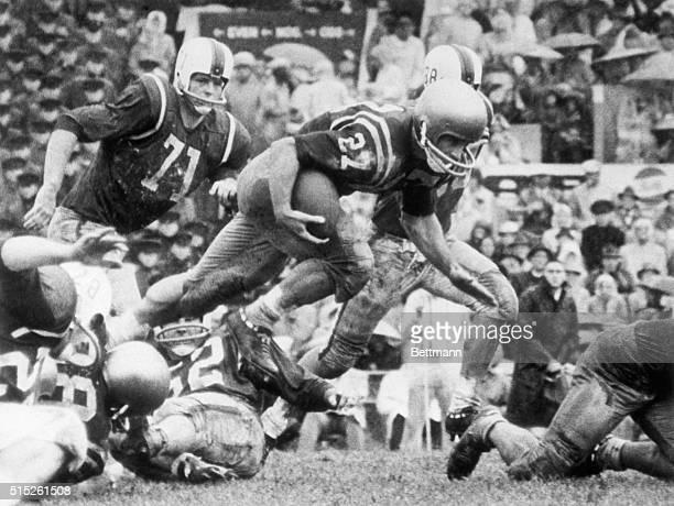 Norfolk, VA- NAVY VS. SMU IN OYSTER BOWL- Joe Bellino, #27, Navy halfback, vaults the SMU line in the third quarter for a 6 yard gain. Jim Hunt, #71,...