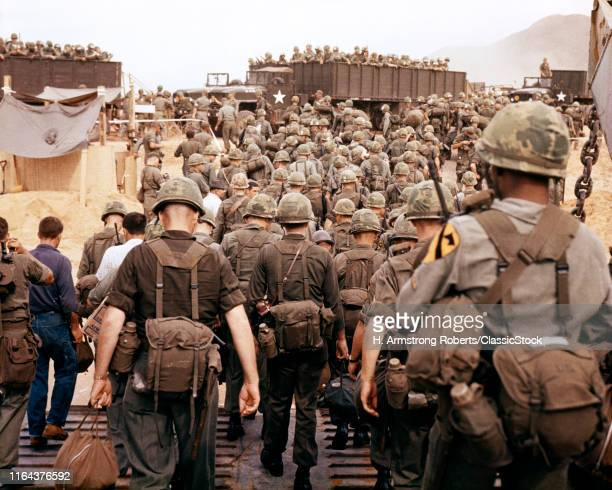 1960s 1965 Arrival Of US Army Soldiers In Vietnam 1St Cavalry Division Airmobile As They Land On Beach