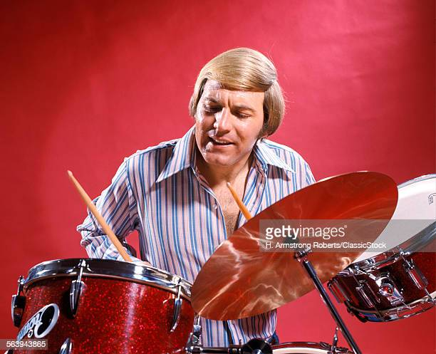 1960s 1970s MAN PLAYING DRUMS