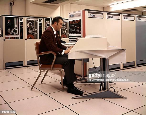 1960s 1970s MAN SITTING...