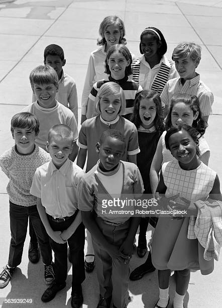 1960s 1970s OVERHEAD OF MULTI ETHNIC GROUP OF BOY AND GIRL STUDENTS OUTDOOR