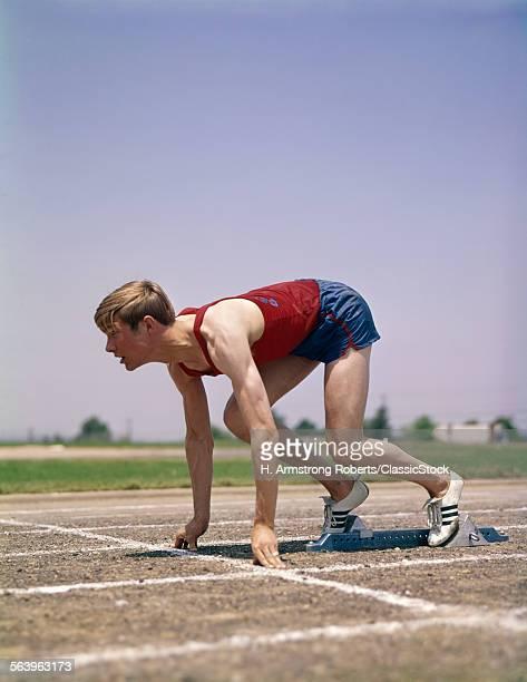 1960s 1970s PROFILE ATHLETE RUNNER IN STARTING BLOCK AT BEGINNING OF RACE