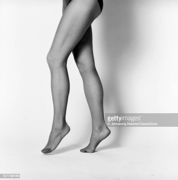 1960s 1970s WOMANS LEGS FROM HIP DOWN STANDING ON TOES WEARING PAIR OF PANTY HOSE