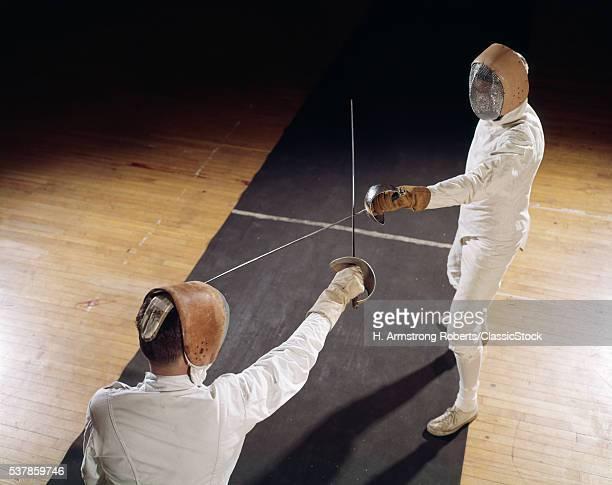 1960s 2 MEN FENCING...