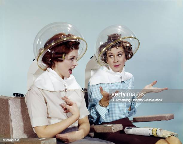 1960s 2 WOMEN SIT UNDER BEAUTY SALON HAIR DRYERS CLEAR HELMETS HOODS CURLERS TALKING GOSSIP