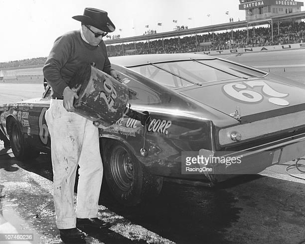 A crewman puts gas in Buddy ArringtonÕs Dodge Charger during a NASCAR Cup race at Daytona International Speedway in the late1960s The gas can and...