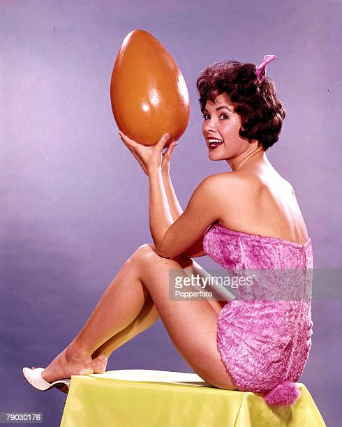1960s A picture of Spanish/American actress Jolene Brand posing holding a giant egg