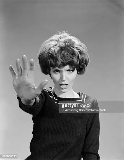 1960s ANGRY WOMAN HAND...