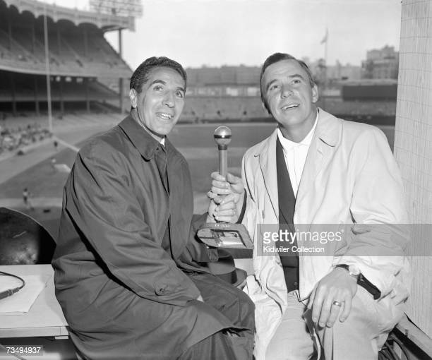 Announcers Phil Rizzuto for the New York Yankees and Pee Wee Reese for NBC pose for a portrait in the press box prior to a game in the early 1960's...