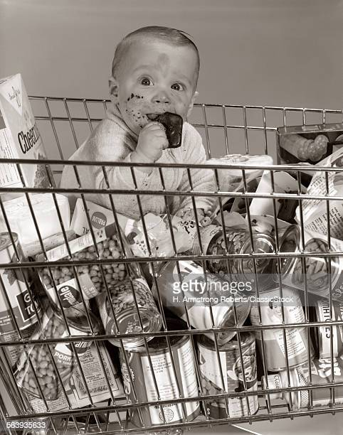 1960s BABY SITTING IN...
