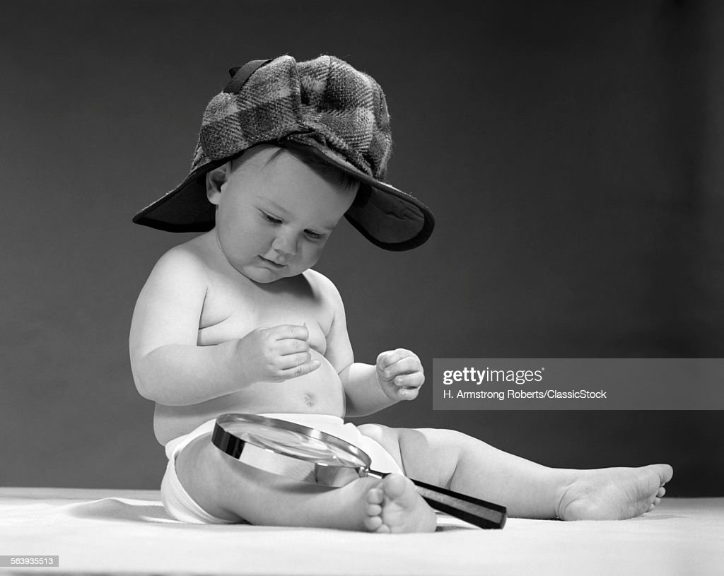 1960s Baby Wearing Stock Photo  71039a133e6