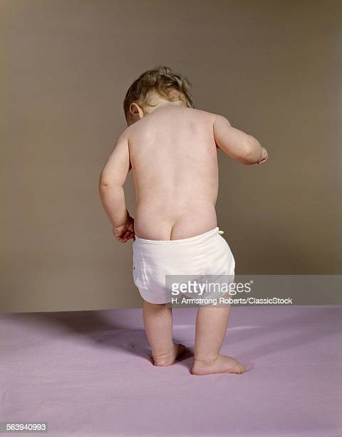1960s BABY WITH DROOPY DIAPER