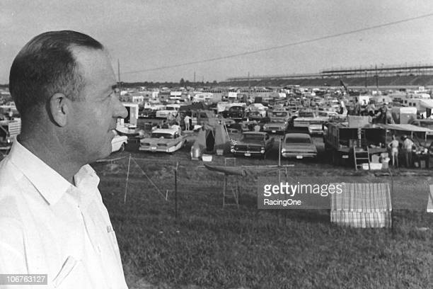 1960s: Barney Wallace, President of Darlington Raceway, surveys his facility and the crowded infield before a NASCAR Cup race in the mid-1960s.