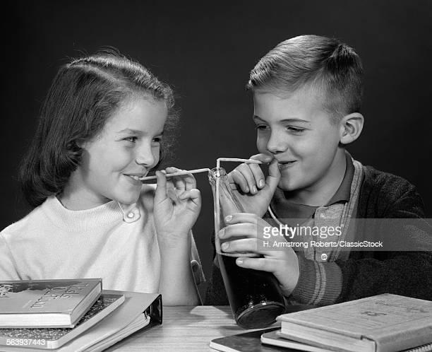 1960s BOY AND GIRL SHARING...