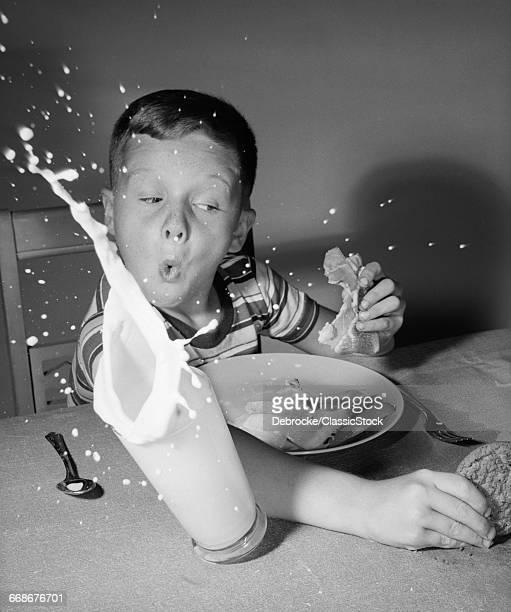 1960s BOY HAVING LUNCH...