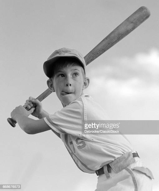 1960s BOY PLAYING BASEBALL...