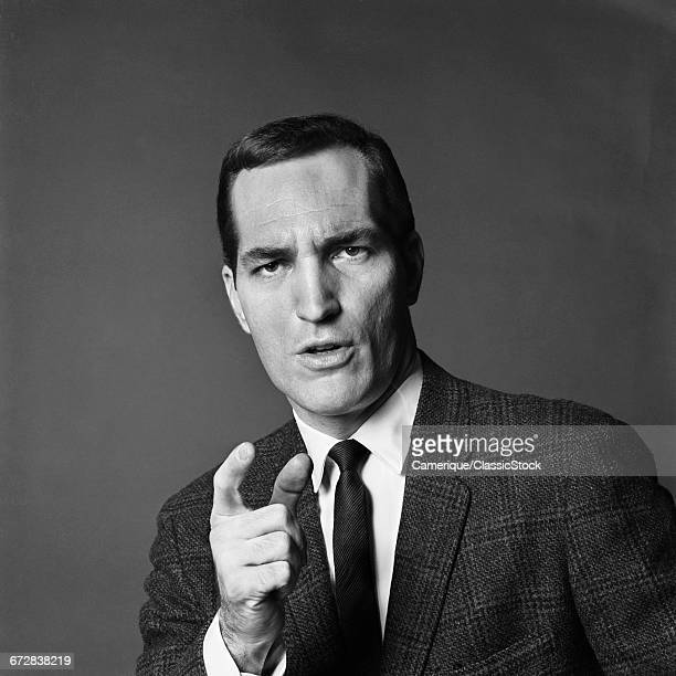 1960s BUSINESS MAN ANGRY FACIAL EXPRESSION POINTING HIS FINGER