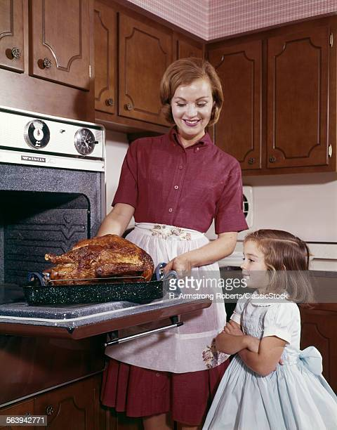 1960s COOKING TURKEY...